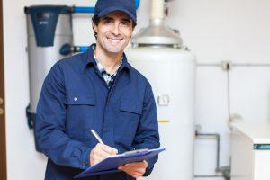 Technician servicing an hot-water heater