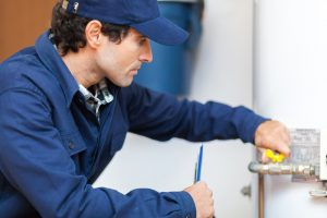 plumber-repairing-hot-water-heater